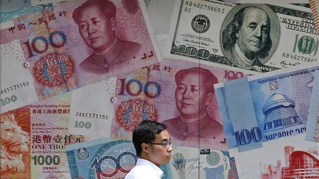 China further weakens yuan rate versus dollar