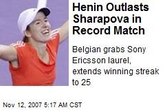 Henin Outlasts Sharapova in Record Match