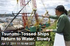 Japan Tsunami Clean-Up: Massive Fishing Ships Returned to Water