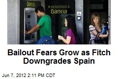Bailout Fears Grow as Fitch Downgrades Spain