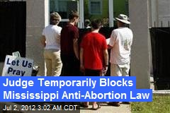 Judge Temporarily Blocks Mississippi Anti-Abortion Law