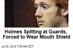 Holmes Spitting at Guards, Forced to Wear Mouth Shield
