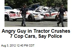 Angry Guy in Tractor Crushes 7 Cop Cars, Say Police
