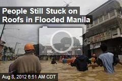 People Still Stuck on Roofs in Flooded Manila