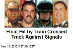 Float Hit by Train Crossed Track Against Signals
