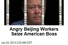 Angry Beijing Workers Seize American Boss