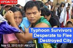 Typhoon Survivors Desperate to Flee Destroyed City