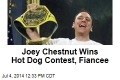 Joey Chestnut Wins Hot Dog Contest, Fiancee