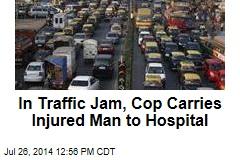 In Traffic Jam, Cop Carries Injured Man to Hospital