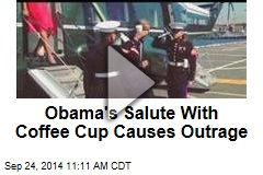 Outrage Over President's Salute With Coffee Cup