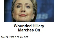 Wounded Hillary Marches On