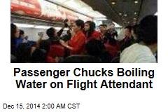 Passenger Chucks Boiling Water on Flight Attendant
