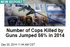 Number of Cops Killed by Guns Jumped 56% in 2014