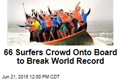 66 Surfers Crowd Onto Board to Break World Record