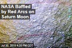 NASA Baffled by Red Arcs on Saturn Moon