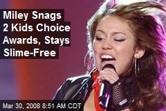 Miley Snags 2 Kids Choice Awards, Stays Slime-Free