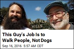 This Guy's Job Is to Walk People, Not Dogs