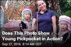Does This Photo Show Young Pickpocket in Action?