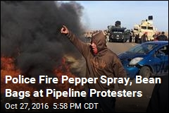 Police Fire Pepper Spray, Bean Bags at Pipeline Protesters