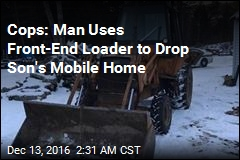 Cops: Man Uses Front-End Loader to Drop Son's Mobile Home