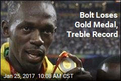 Bolt Loses Gold Medal, Treble Record