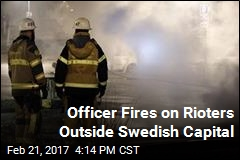 Officer Fires on Rioters Outside Swedish Capital