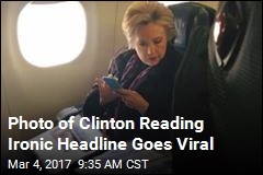 Photo of Clinton Reading Ironic Headline Goes Viral