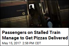 Pizza Guy Delivers 2 Pies to Passengers on Stalled Train
