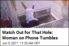 Watch Out for That Hole: Woman on Phone Tumbles