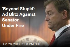 'Beyond Stupid': Ad Blitz Against Senator Under Fire