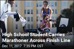 High School Student Carries Marathoner Across Finish Line