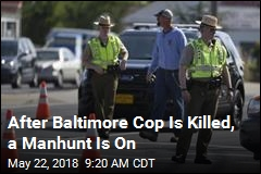 After Baltimore Cop Is Killed, a Manhunt Is On