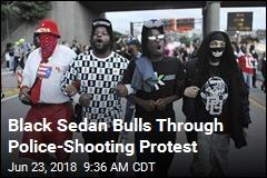 Black Sedan Bulls Through Police-Shooting Protest