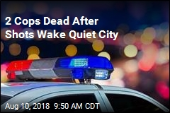 2 Cops Dead After Shots Wake Quiet City
