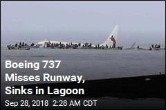 Plane Overshoots Runway, Sinks in Pacific Lagoon