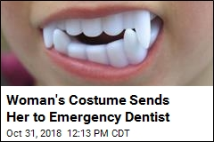 Woman's Halloween Fangs Get Stuck on Her Teeth