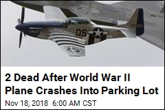 World War II Fighter Plane Fatally Crashes Into Parking Lot