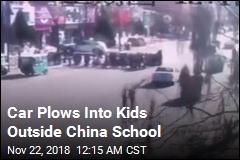 Car Strikes Crowd Outside China School
