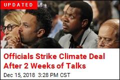 Officials Strike Climate Deal After 2 Weeks of Talks