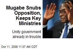 Mugabe Snubs Opposition, Keeps Key Ministries