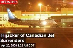 Hijacker of Canadian Jet Surrenders