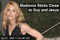 Madonna Sticks Close to Guy and Jesus
