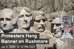 Protesters Hang Banner on Rushmore
