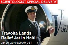 Travolta Lands Relief Jet in Haiti