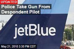 Police Take Gun From Despondent Pilot