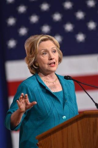 Clinton Goes After Bush as They Address Same Event