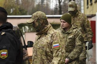 Ukraine President Dons Fatigues, Brings in Martial Law