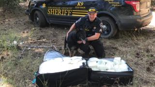 In 4M-Acre Forest Sat Suitcases Holding $1M of Meth