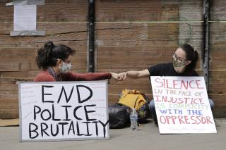 Cities Roll Back Police Tactics, Tear Gas