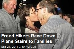 Freed Hikers Race Down Plane Stairs to Families